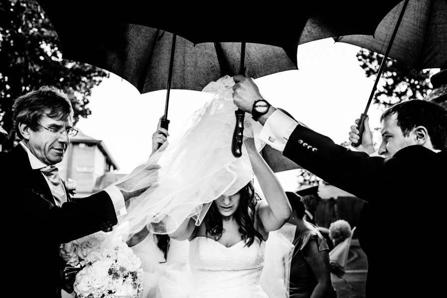 Photo Of The Day: A Bride Is Rescued From A Rainy Day By Pete Henderson